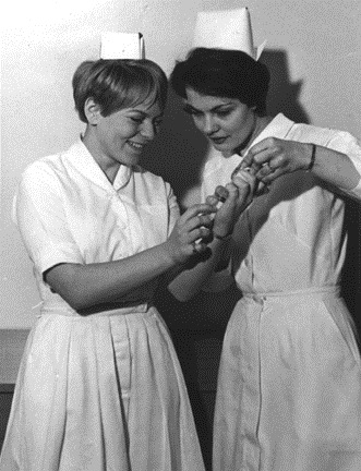 photos_two_girls_with_syringe_1960s.jpg
